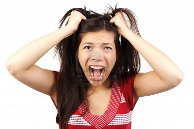 5412538-frustrated-and-angry-mad-woman-going-crazy-hands-pulling-her-hair-isolated-on-white-background